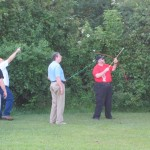 Steve, KC5SAS, prepares to shoot a line over a tree for the 80m antenna, while Vernon, AA5O, Marvin, N5HE, and Jerry, W5AJD supervise.
