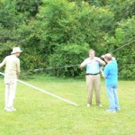 Frank, Vernon AA5O and Ken W5KQ tie down the end of the 80m inverted vee.