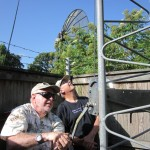 Thornton, KG5HLC does the cranking while Jim, N5IB, watches the dipole.