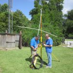 Brook, N5DGK, and Ken, W5KQ, work on the 6m antenna.