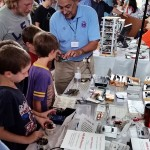 Jim explaining some home-brew circuits to young visitors