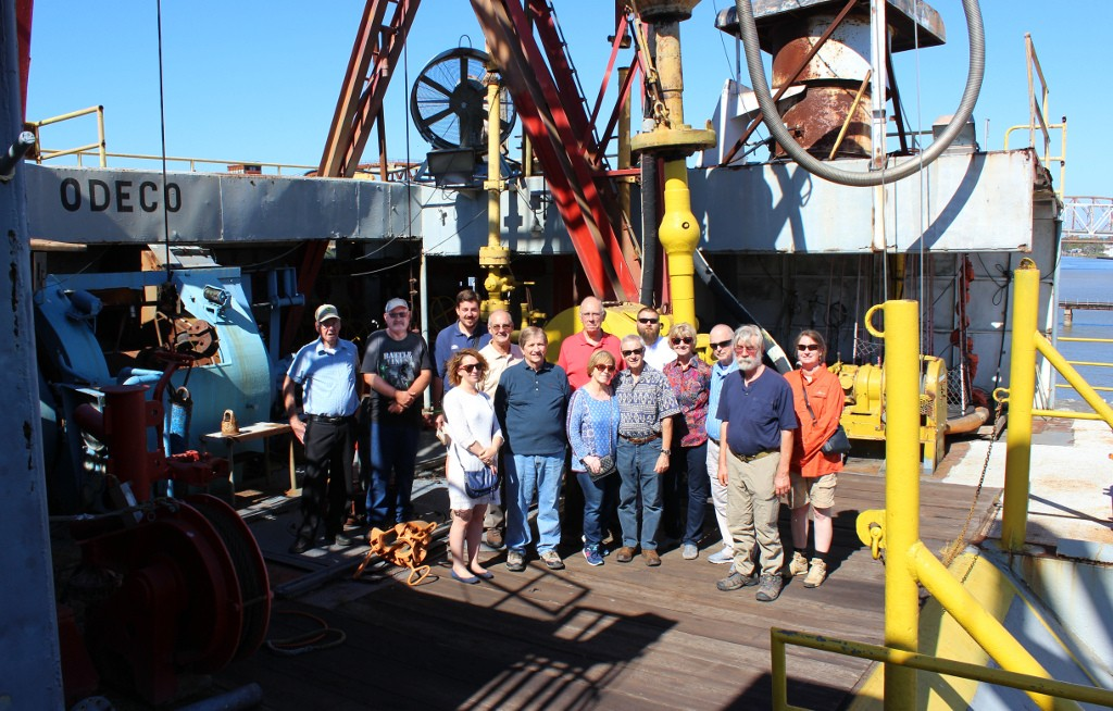 On the drilling floor of Mr. Charlie.  The derrick is directly above their heads. The lady in 	white dress and the man in line directly behind her are French tourists